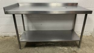 Stainless steel preparation table with corner upstand