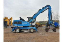 Fuchs MHL320 Waste Rehandler