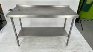 Large stainless steel prep station.