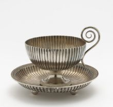 A bouillon cup with saucer