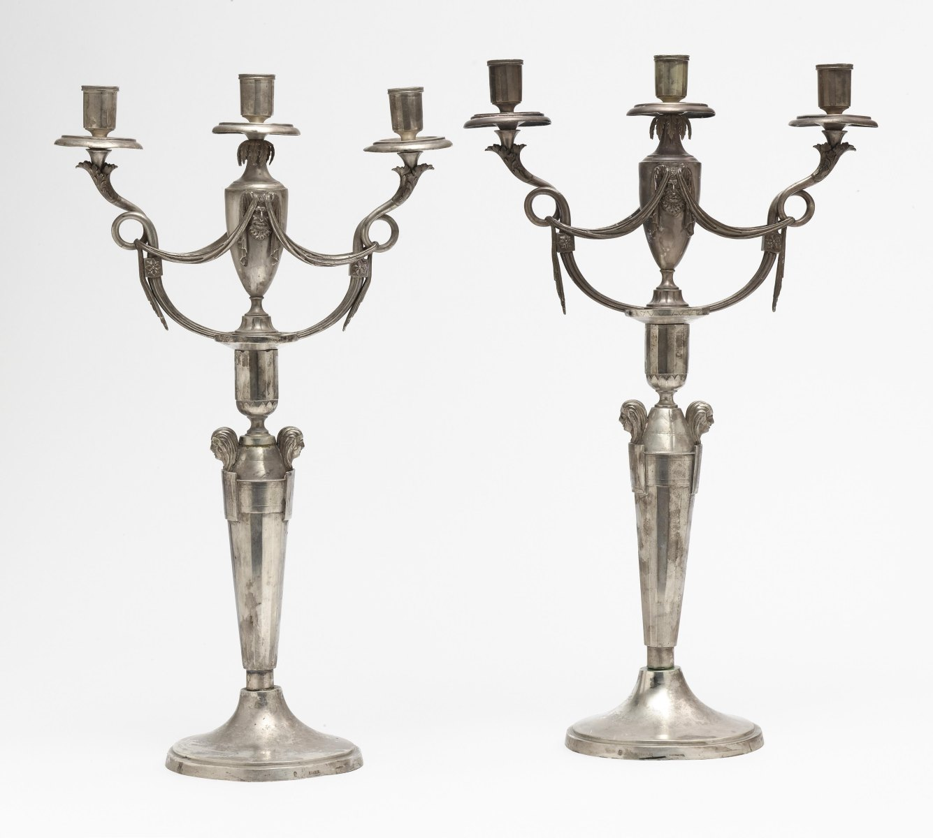 A pair of three-light girandoles
