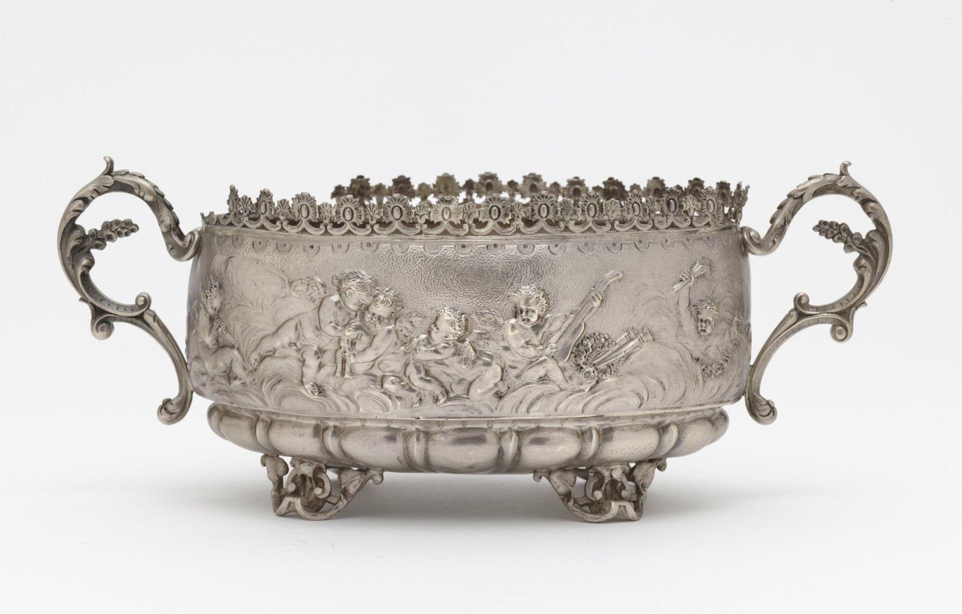 An oval handled bowl