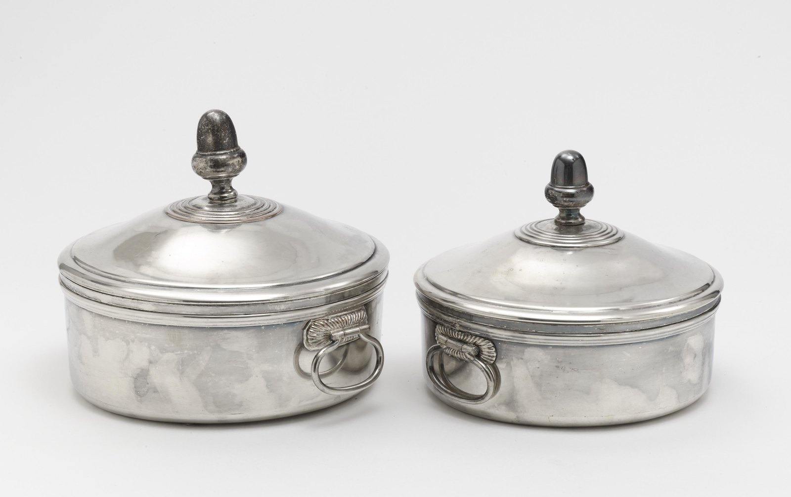 Two lidded tureens and a pair of oval platters