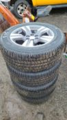 (4) 265 60 18 tires and rims