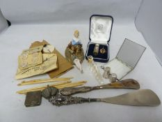 Ladies Vintage Accesories - a German porcelain pin-cushion dolls; two silver mounted shoe horns; a