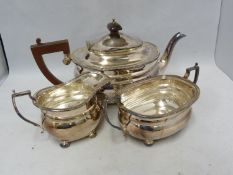 An Adie Brothers Limited silver plated tea service, comprising, teapot with hinged cover, milk jug
