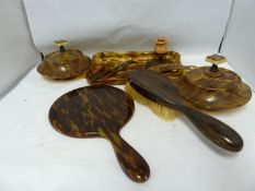 An early plastic Art Deco Dressing table set, includes tray, powder bowl, hair pot and cover,
