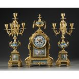 A FRENCH ORMOLU AND BLUE PORCELAIN CLOCK SET, 19TH CENTURY