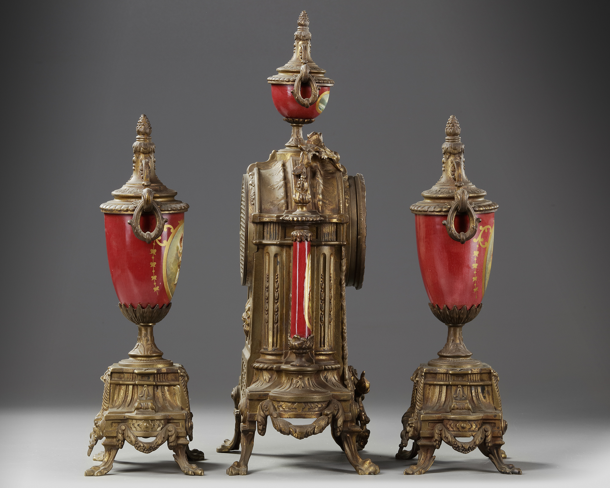 A SPELTER AND RED PORCELAIN CLOCK SET, 19TH CENTURY - Image 3 of 4