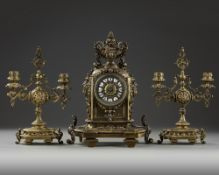 A NEO-RENAISSANCE STYLE BRONZE CLOCK AND CANDLELABRA SET, LATE 19TH CENTURY
