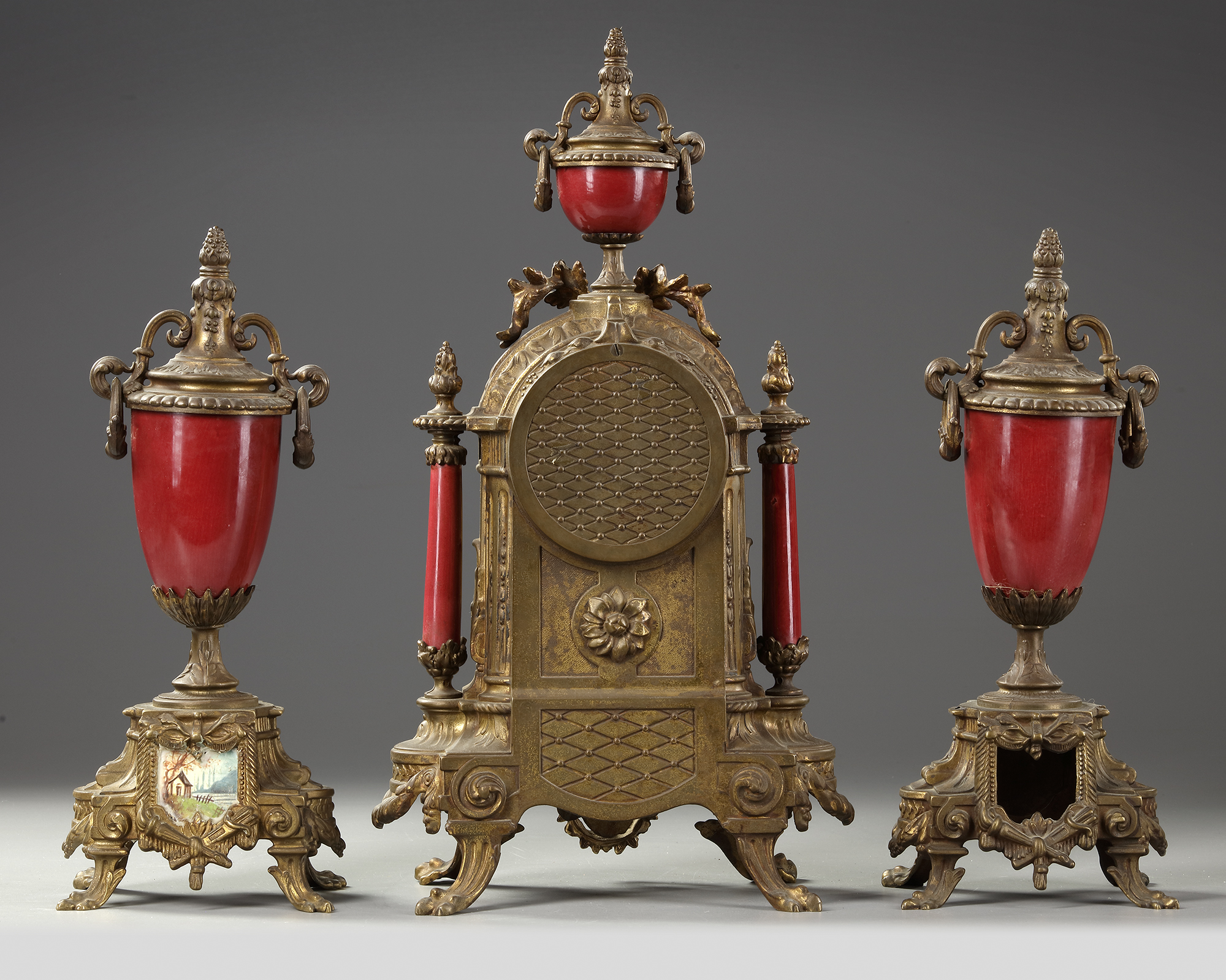 A SPELTER AND RED PORCELAIN CLOCK SET, 19TH CENTURY - Image 4 of 4