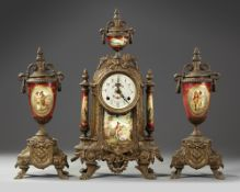A SPELTER AND RED PORCELAIN CLOCK SET, 19TH CENTURY