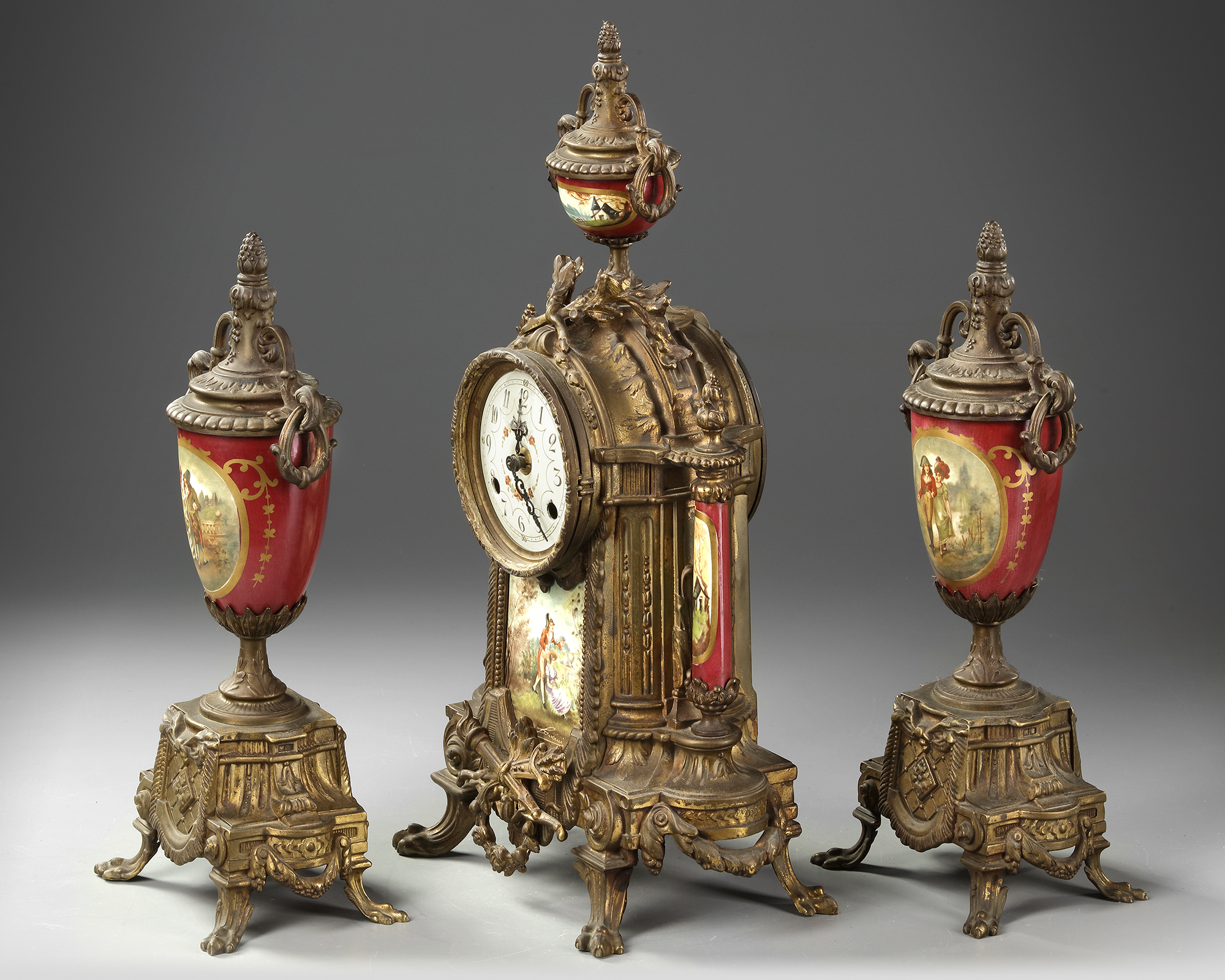 A SPELTER AND RED PORCELAIN CLOCK SET, 19TH CENTURY - Image 2 of 4