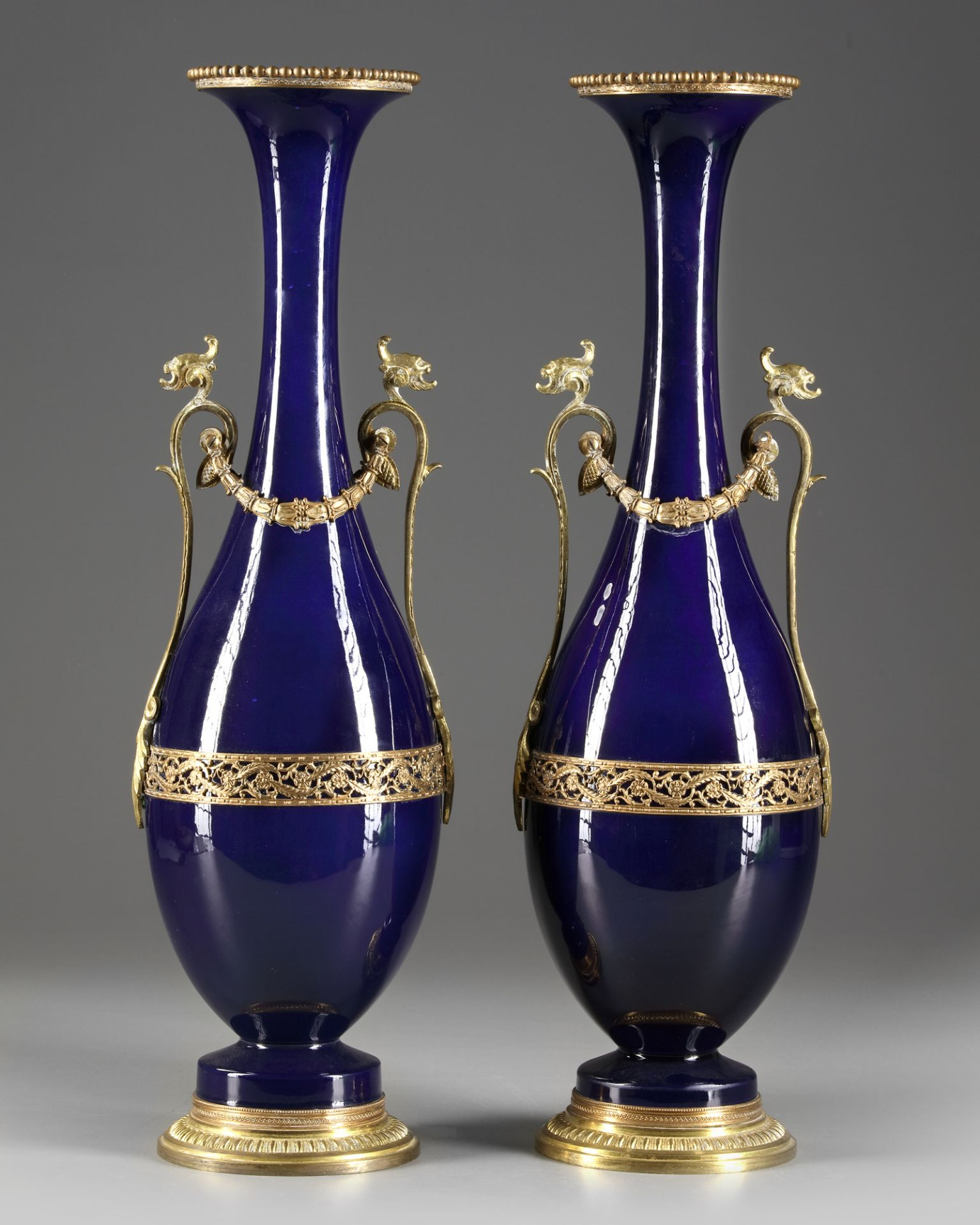 A PAIR OF FRENCH BLUE PORCELAIN VASES, CIRCA 1900