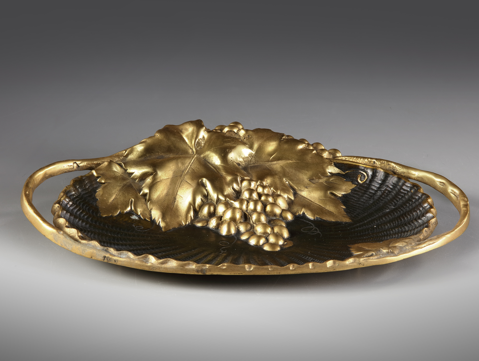 A FRENCH GILT BRONZE 'VIDE POCHE', CIRCA 1900