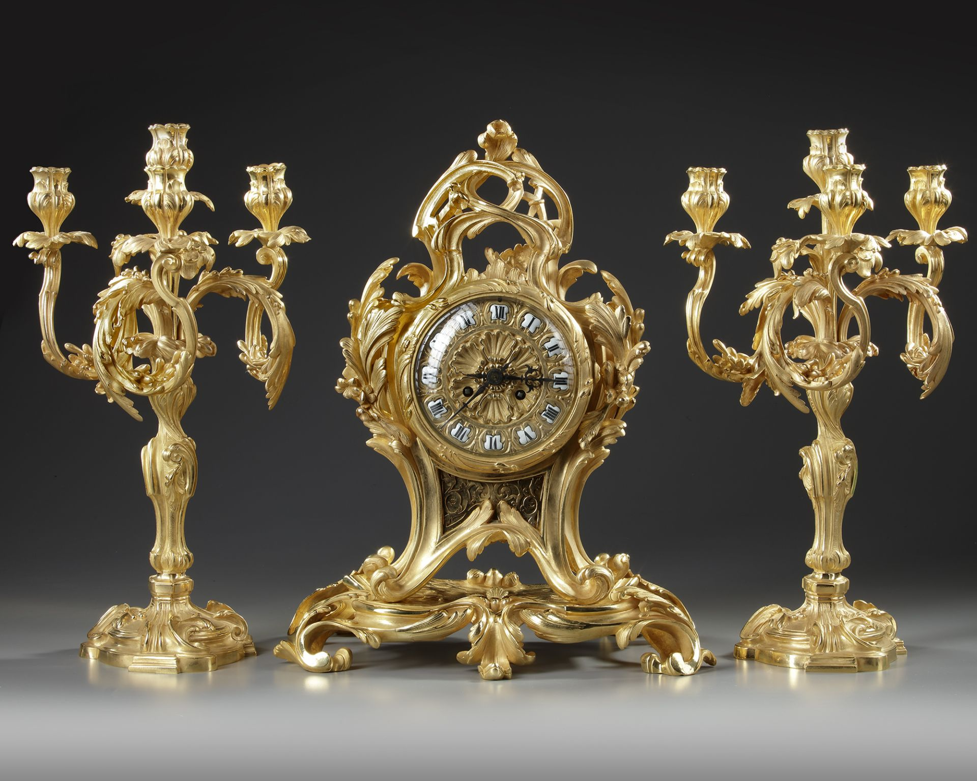 A FRENCH ORMOLU CLOCK SET, 19TH CENTURY