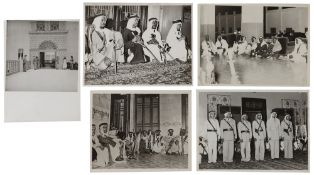 FIVE PHOTOGRAPHS OF AL-SAUD ROYAL GUARDS WITH THEIR TRADITIONAL WEAPONS AND UNIFORMS, DURING DUTY AT