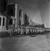 A COLLECTION OF SIX PHOTOGRAPHS OF THE SAUDI ARMY COMMANDERS, OFFICERS AND SOLDIERS DURING A PARADE,