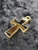 Gold banded agate cross.