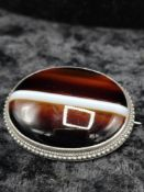 Large tiger eye style brooch.