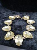 Yellow stones large pear shapes antique setting bracelet.
