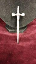Celtic white metal kilt pin shape of a sword marked RA.