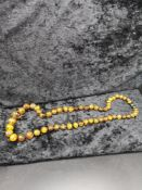 Set of Amber style beads. Has damage to grey end.