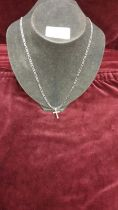 Silver 24 inch figaro chain with cross.