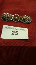 Silver fillagree brooch with centre pearl.