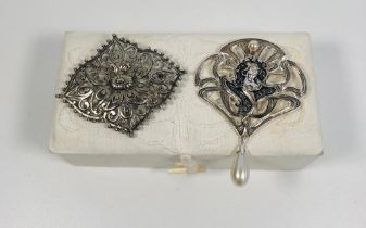 2 decorative Silver brooches includes 1 signed Hollywood brooch with box.