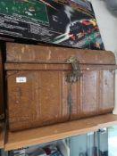 Vintage metal travel trunk.
