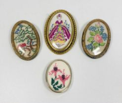 Collection of 4 detailed vintage embroidered brooches.