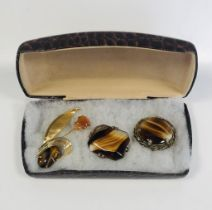 3 stunning vintage gold metal brooches that include 2 Tigers Eye art glass brooches.