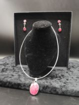 Silver stunning necklace set in the large Red stones with matching earrings.