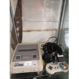 Super Nintendo with controller and accessories.