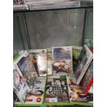 Shelf of xbox 360 & ninetendo wii games.