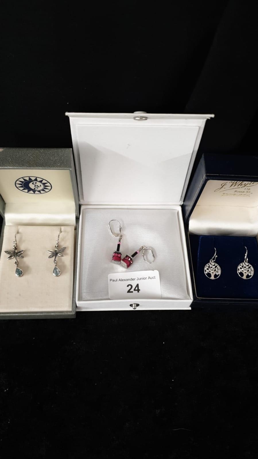 3 Silver earring sets .