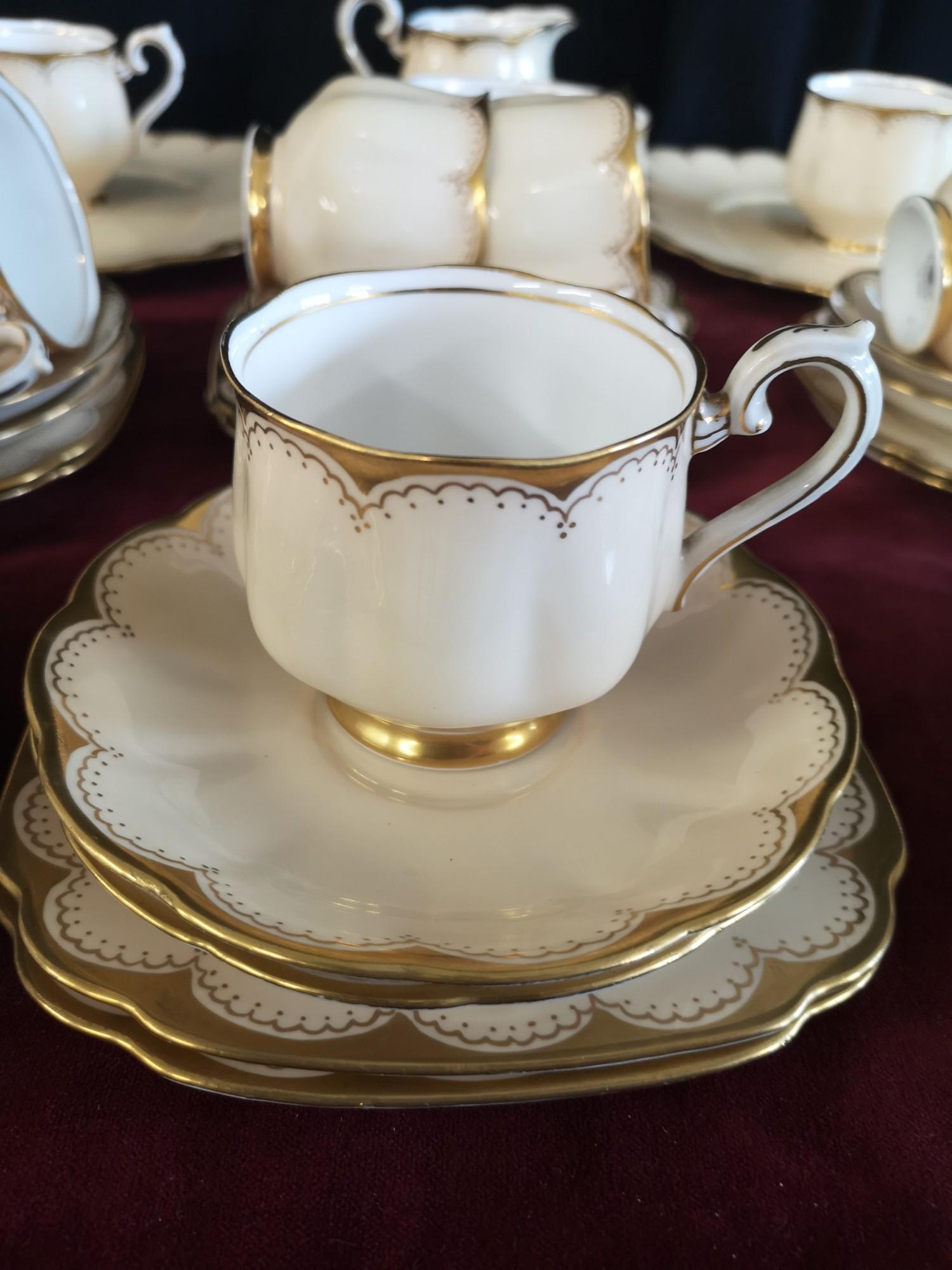 Large 1900s Royal Albert gilt tea set, set in cream back ground. - Image 9 of 10