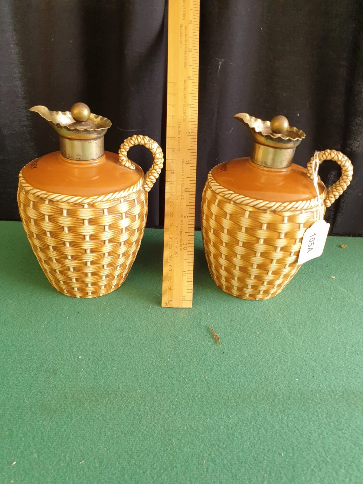 Pair Of Victorian Glazed Pottery Flagons With Silver Plated Pourers And Stoppers.