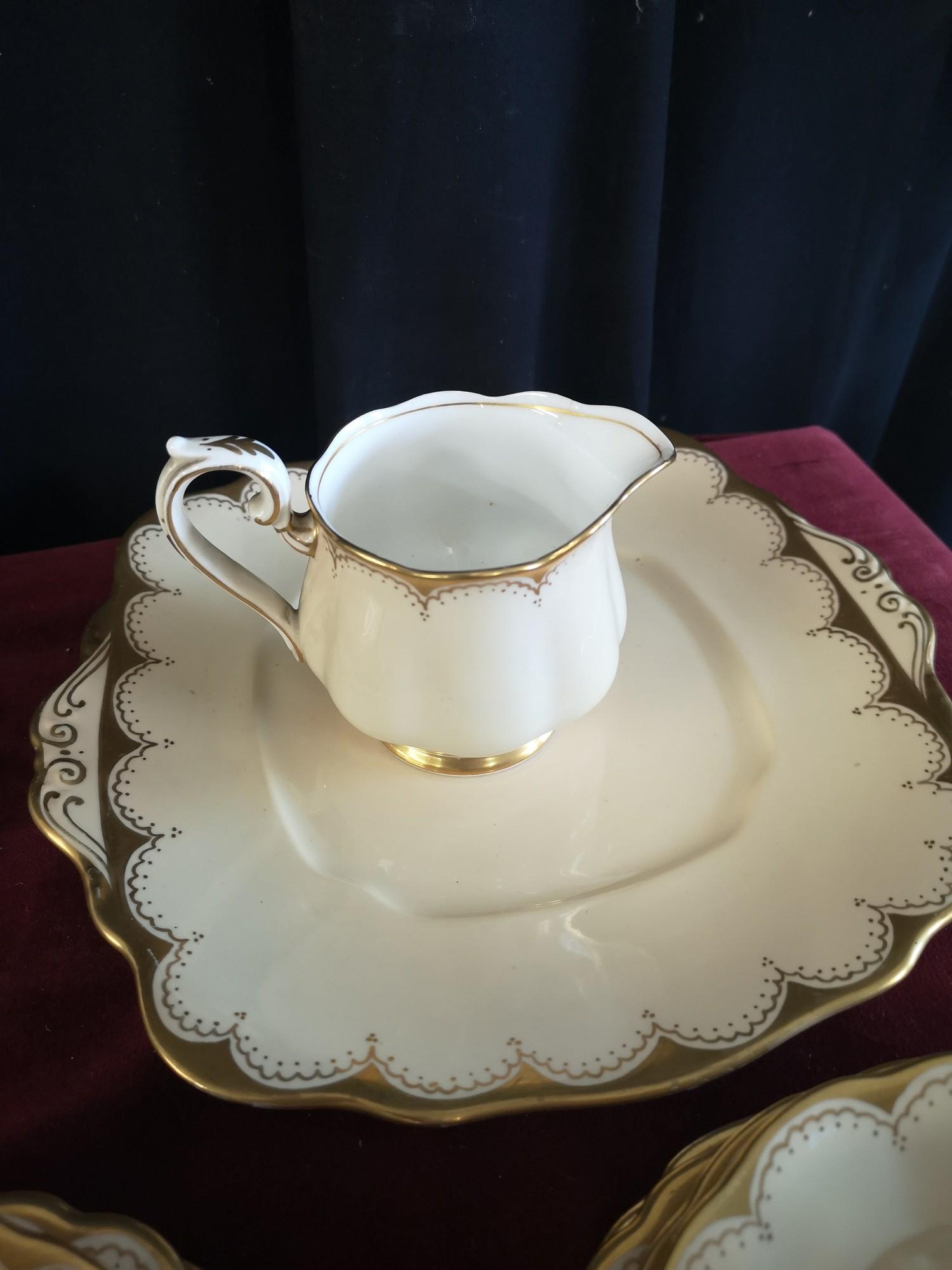 Large 1900s Royal Albert gilt tea set, set in cream back ground. - Image 3 of 10