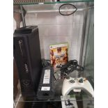 Xbox 360 console with controller and game.