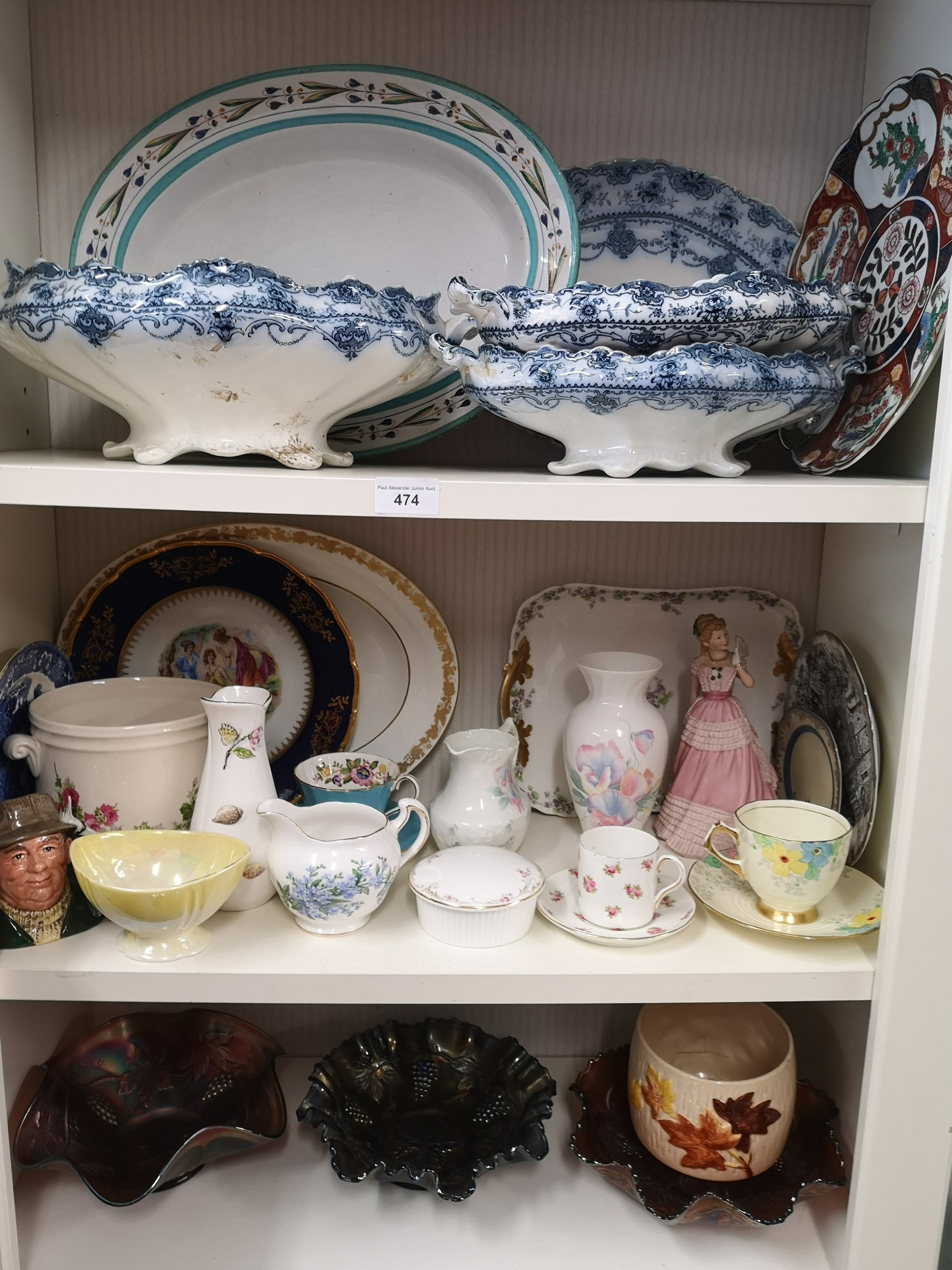 3 shelfs of collectables includes carnival glass, carlton ware etc.