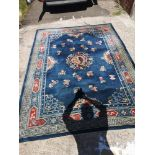 Large woven dragon pattern rug. 86 inches width, by 116 inches in length.