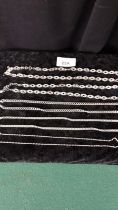 Selection of silver necklaces etc .