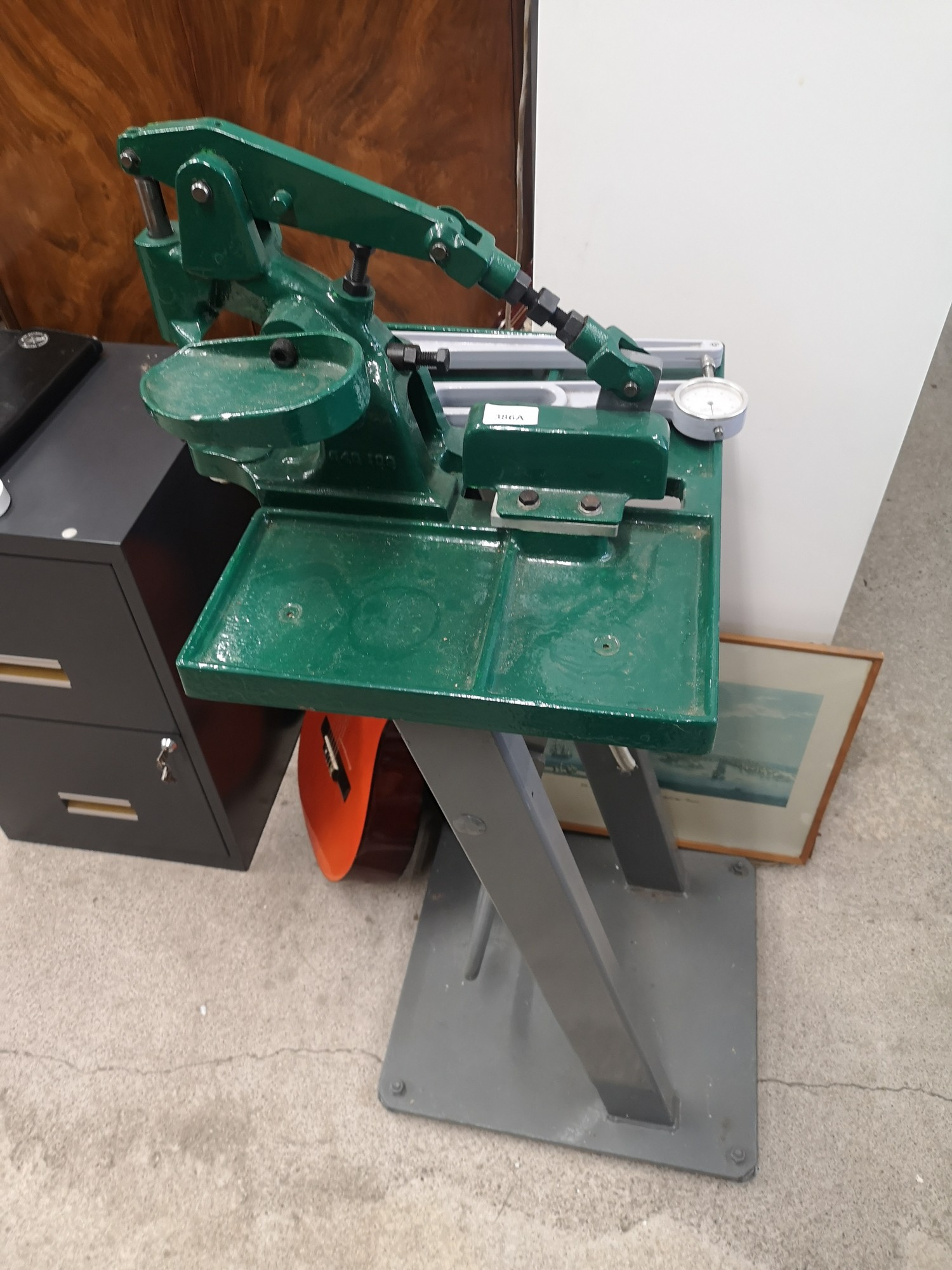 Large heavy metal leather punch tool bench.