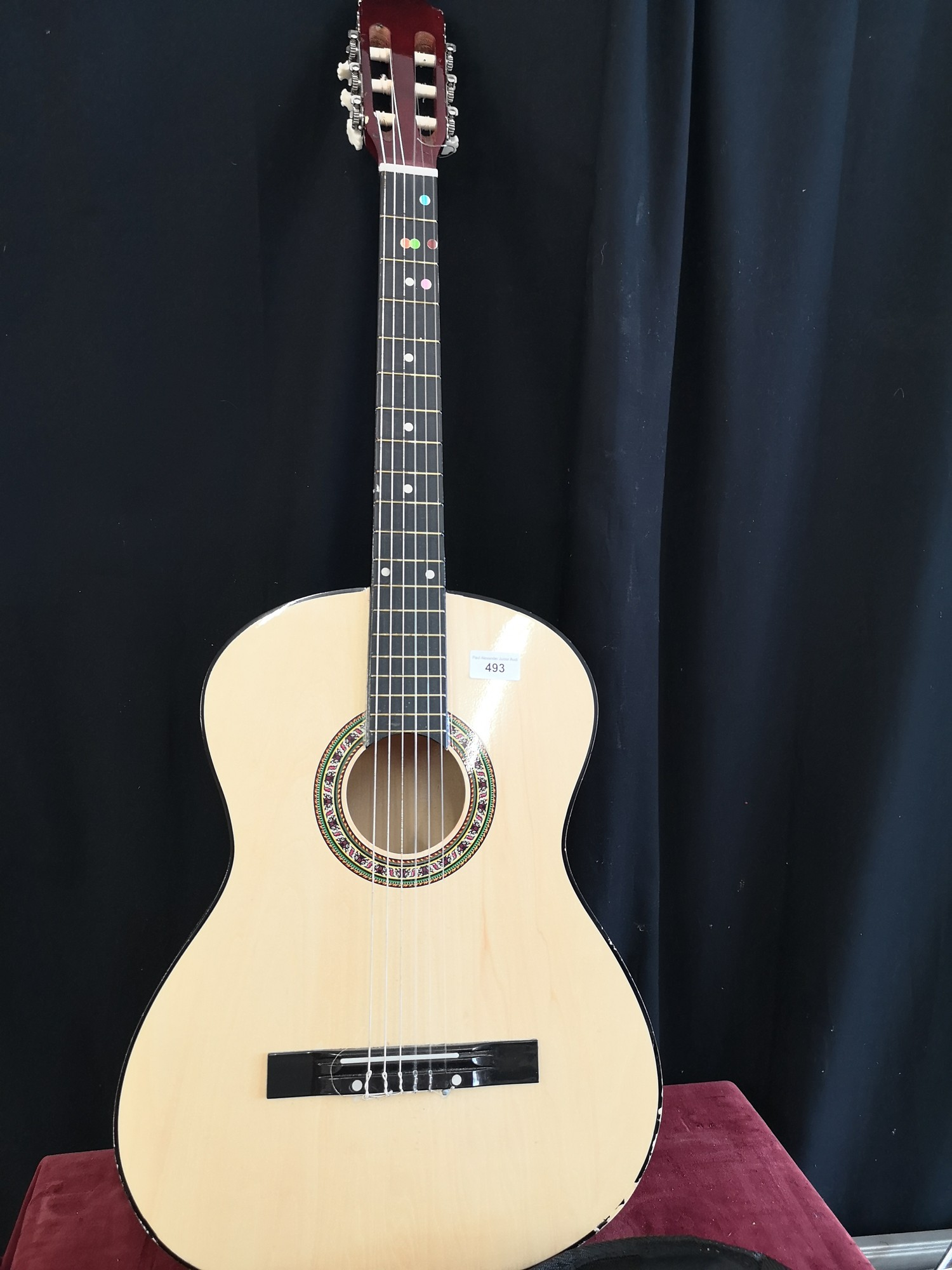 Acoustic guitar with inlaid pattern.