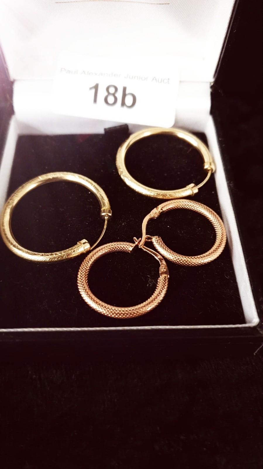 2 Pairs of 9ct gold hoop earrings . 4 grams .