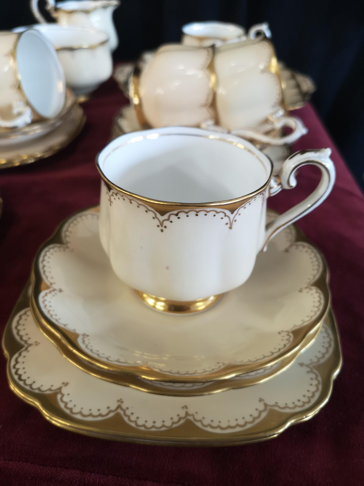 Large 1900s Royal Albert gilt tea set, set in cream back ground. - Image 8 of 10