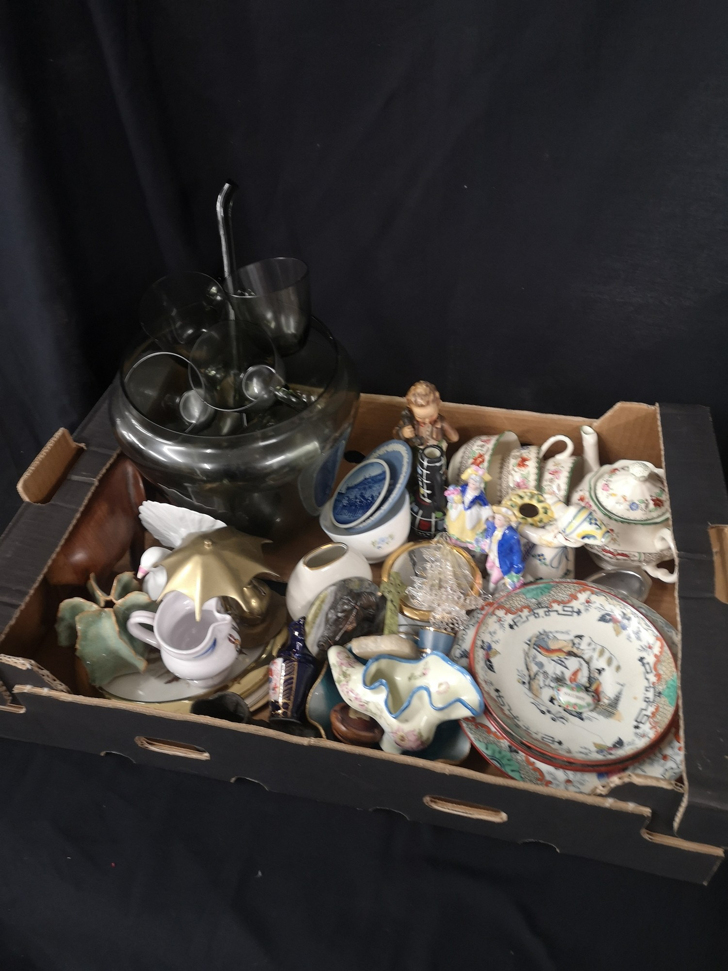 Box of collectables includes hummel, art smoked glass punch set and other collectables.