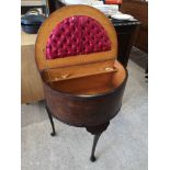 Ornate half moon sewing box with fitted interior.
